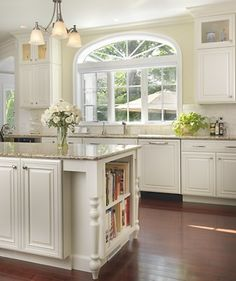White kitchen in Pawtucket, RI, featuring Schrock Cabinets. Designed by Lisa Zompa of Kitchen Views, Warwick, RI