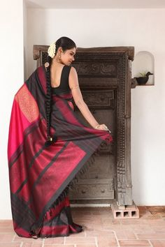 Pink Thread Work Kanjivaram Saree with Balck Border paired with black plain sleeveless blouse.