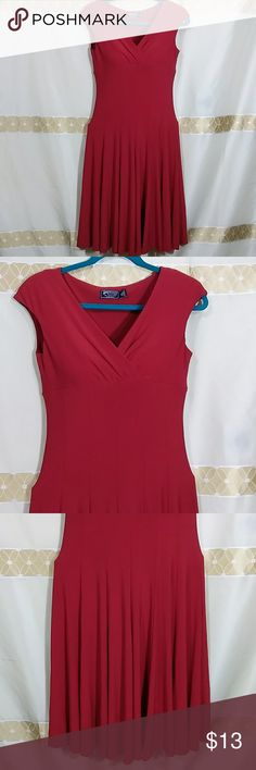 Red American Living Dress I-94 Gorgeous dress waistline  fitting with flare skirt.  Heavy stretch thick fabric  in perfect condition  Measurements laying flat  Bust: 16.5 inches Waistline:15 inches Length: 35 inches Pet/smoke free home American Living Dresses Midi