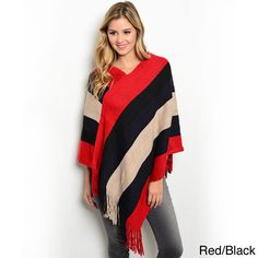 This thick ribbed knit poncho pullover with colorblock stripes isyour must have cold weather accessory. Soft fringe trim andmetallic stitching add to the overall style of this fashionessential. Knit Shrug, Knitted Poncho, Striped Knit, Diy Clothing, Black Sweaters, Black Stripes, Trendy Outfits, Fringe Trim, Knitting