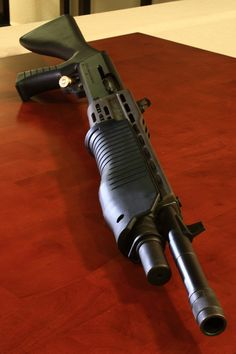 Spas 12 - Semi-auto 12 gauge. Because pumping steals valuable time.