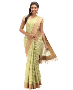 Chanderi Fabric. Body is Pista green color chanderi cotton with off white n golden color thread butties with border. Attached golden border. Pallu is Pista green color chanderi cotton with off white n golden color thread butties with saree border. Blouse is Golden tissue with narrow border.