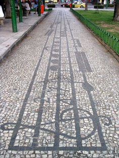 Musical Pavement - Vila Isabel, Rio de Janeiro, Brazil The mosaic sidewalks along Boulevard 28 de Setembro between Praça Maracanã and Praça Barão de Drummond are musical staves. :)