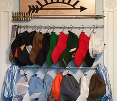 Hat storage solution - Finally, a solution to organize all of my sons' baseball hats. Cafe curtain rods with shower curtain hooks.