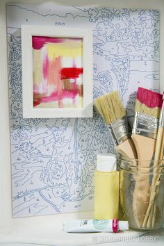 This artsy alcove was created with a paint-by-numbers sheet, mini painted canvas and a frame.