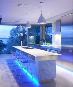Love the lights & stainless & carerra marble Dramatic Contemporary Kitchen by Mal Corboy http://www.homeportfolio.com/Designers/Room/16723
