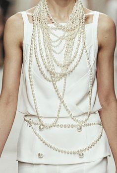 Chanel cruise 2014. Have I mentioned that you can never wear too many or too few strings of pearls?