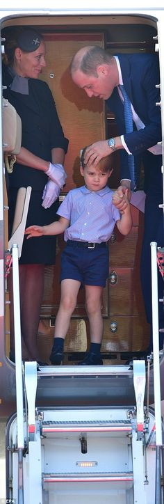 Doting father Prince William gave his son a reassuring pat on the head before they exited the plane