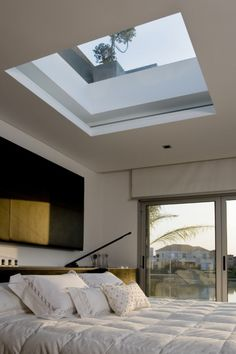 skylight above bed - would need to be able to cover it up  Waterfall House / Andres Remy Arquitectos