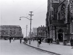 Pedestrians in Cathedral Square, looking up Colombo Street north, Christchurch 1930