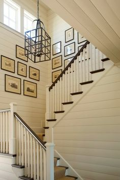 Traditional Stair Case. The horizontal siding really gives it effect!