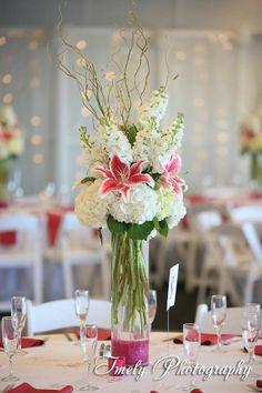 Elegant tall centerpiece hydrangea and stargazers by Beneva Flowers Sarasota Florida