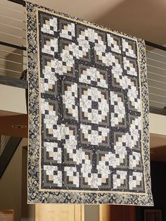 A FORMAL AFFAIR by Toby Lischko: This black and white quilt pattern might only feature two colors with touches of beige here and there but it is still filled with powerful interest. While this quilt has a tribal feeling to the aesthetic, it also fits perfectly into any home with the beautiful and traditional log cabin quilt units shown throughout this top. So elegant, but it's a deceptively simple design, relying on a single Log Cabin block.