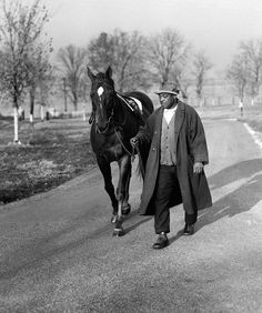 1919: The storied racehorse Man O'War lost his only race to the unknown Upset at Saratoga Legendary thoroughbred Man O'War is led back to the barn by his lifetime caretaker and groom, Will Harbut, after morning exercise in Lexington, KY., Nov. 25, 1939. Man O'War, winner of 20 of his 21 starts, and Harbut both died within a month of each other in 1947.  (AP Photo/PS) ORG XMIT: APHS113