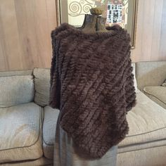 Vintage Black Rivet Rabbit Fur Poncho Vintage Black Rivet Rabbit Fur Poncho. Mint condition. Very luxurious. Vintage Sweaters Shrugs & Ponchos
