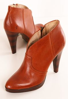 Frye Harlow cognac booties- These pebbled leather platform booties feature a pointed toe and a notched top line.