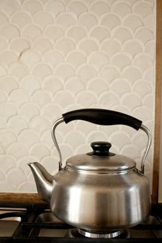 a nice break from all the MCM decor, some hints of Scandinavia and Japan- Mjolk Kitchen Backsplash/Remodelista