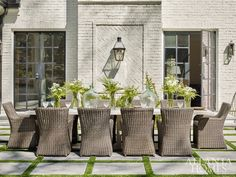 Just off the family room is a handsome outdoor dining area atop a patio of bluestone pavers. Featuring a custom concrete table by Kleinhelter and Kingsley-Bate's Sag Harbor seating, the setup is framed by striking steel doors and a brick accent wal Brick Accent Walls, Outdoor Dining, Outdoor Decor, Outdoor Rooms, Outdoor Dining Area, Outdoor Design, Outdoor Furniture Sets