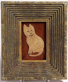 beaded cat in a multi layered primitive frame