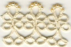 This could make a gorgeous Victorian style garter with a bit of blue satin ribbon woven through the bottom ring of the pattern there and the beaded side hanging down