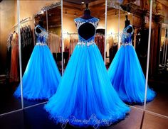 Be the princess at the ball in this fabulous Ball Gown in brilliant blue! Its high neckline bodice is covered with large crystals cascading into the sheer midriff. The keyhole back completes this fabulous gown! ONLY at Rsvp Prom and Pageant, Atlanta, GA