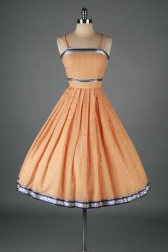apricot sundress with nice contrasting ribbon