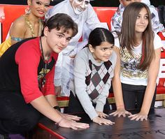 "Michael Jackson's children Prince Michael, Blanket and Paris Jackson press their hands into cement at the Michael Jackson ""Immortalized"" hand and footprint ceremony at Grauman's Chinese Theatre in Hollywood on January 26th, 2012."