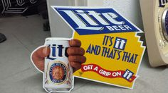 Lite BEER / IT'S it AND THAT'S THAT / GET A GRIP ON IT. - Hand Holding Miller Lite Beer Can - Metal Sign