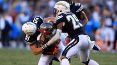 Kyle Emanuel #51  and  Craig Mager #29 of the San Diego Chargers bottle up Freddie Martino #16 of the Tampa Bay Buccaneers during the second half of a game at Qualcomm Stadium on December 4, 2016 in San Diego. (Getty Images)