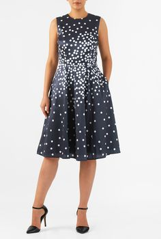 A jewel neck tops our graduated polka dot print polydupioni dress designed with a fitted tank bodice and seamed waist atop a full flare skirt.