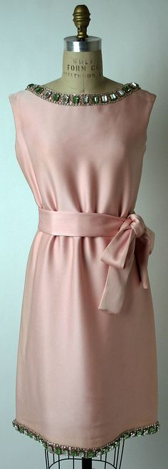Rhinestone-embellished pink silk evening dress with low scoop back and self-fabric sash, by Norman Norell, American, ca. 1968.