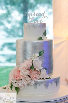 Modern white and silver wedding cake with sugar flowers of peonies and roses. By My Daughter's Cakes, Dumont, NJ. Photography by Fede Photography fedephotography.com
