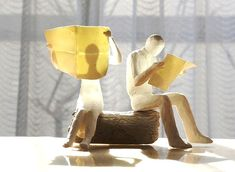 tanaka kazuhiko's mini sculptures: Newspaper/The Man, clay stone powder, tinted watercolor or acrylic