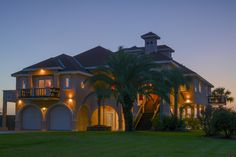 Twilight brings out the architectural masterpiece this Texas Coastal Villa is. Welcome Home.....