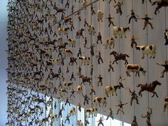 Curtain of Cows & Cowboys by woolly fabulous: Spotted at the 'W' Hotel in Dallas! #Hanging_Curtain #Figurines