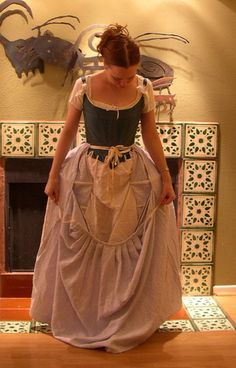 I love Katherine's dress diary website. Here she demonstrates how to put on an authentic 18th century petticoat with twill tape waistband. Am in the process of making same now.