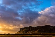 Beautiful and dramatic sunset - Dramatic sunset sky over cliff in southern Iceland