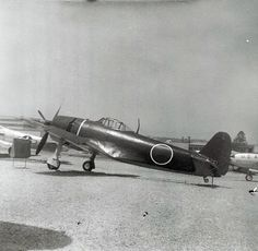 "A captured Jap Zero. *note the large red ""meatball"" painted on its side...."