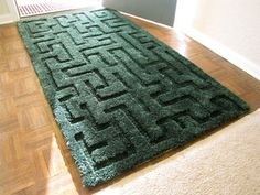 Hedge Maze Area Rug — marbles, cars, etc.  This is a regular rug modified with an electric clipper.