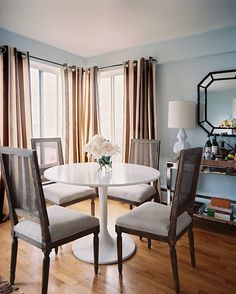 Dining Room Traditional Photo - A white tulip-style table with French-inspired dining chairs
