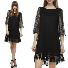 Black Boho Hippie Fringe Lace Tunic Dress Festival ready tunic dress. Boho style vintage looking lace details. Cotton macrame fringe trimming at skirt hem. 1/2 length sleeves. 80% Cotton, 20% Nylon. 100% Polyester lining. Fully lined. Reminiscent of Free People and Show Me Your Mumu.  Length from shoulder to tip of fringe is 36 inches. Last image shows exact detail but in cream. Dresses