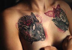 Beautiful tattoo just above breasts