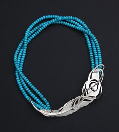 Sterling silver Peacock feather necklace with turquoise beads. Copyright Robyn Nichols