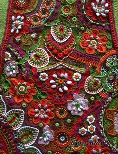 Freeform crochet blanket with beautiful and colorful flowers and leaves