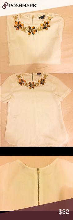 Ann Taylor silk-similar White Top Petite XXSP, not so small because of the design. The fabric don't show any wearness. Feels like silk. Really fashionable and easy to match. Ann Taylor Tops Tees - Short Sleeve