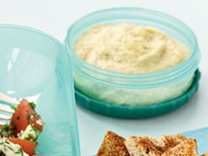 Lemony Hummus with Spicy Whole-Wheat Pita Chips | Packed with good-for-you fats, hummus is a favorite go-to for quick, healthy snacks and hors d'oeuvres.