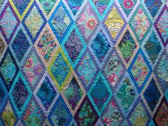 This quilt belongs to Diann. Don't you just LOVE those Kaffe Fassett fabrics! I just did a simple overall swirl quilting. I usually onl...