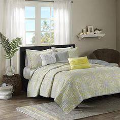The Caicos Coverlet Set provides a modern coastal look to your home with its overscaled flower motif in shades of yellow and grey. Three decorative pillows create a casual feel with embroidery and fabric manipulation to pull this whole look together.