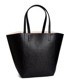 Shopper in grained imitation leather with double handles and small, removable inner bag with zip. Size of inner bag 6 x 7 3/4 in. Size of shopper 13 x 19 in.