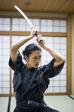 Samurai training in a traditional dojo in Tokyo - Japanese martial arts athlete training kendo in a dojo - Samaurai practicing in a gym Action Pose Reference, Human Poses Reference, Pose Reference Photo, Body Reference, Anatomy Reference, Samurai Poses, Action Posen, Sword Poses, Bushido